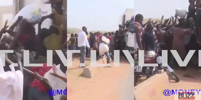 Watch As Hungry Nigerians Attack Truck Carrying Food Supplies to Steal Food Items - Video 1