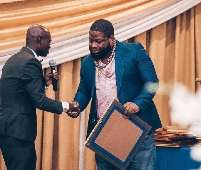 d-black receives and award from Dr. Fordjour