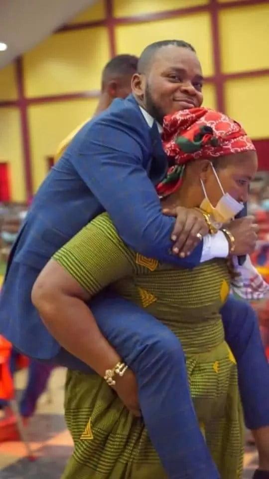 Church members carrries Obinim at her back