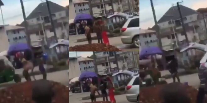 2 Sakawa boys bath in the middle of the road as a native doctor performs rituals on them - Video 1
