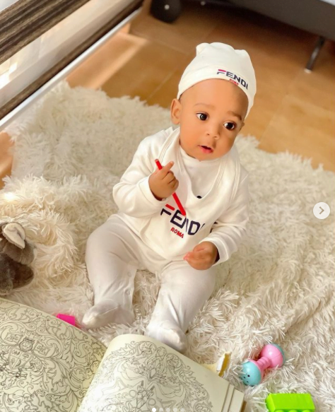 Regina Daniels teaches her 6-month-old baby how to write in new photos