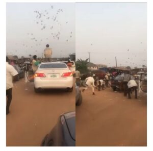 Yahoo Boys spotted throwing money on the streets - Video 2