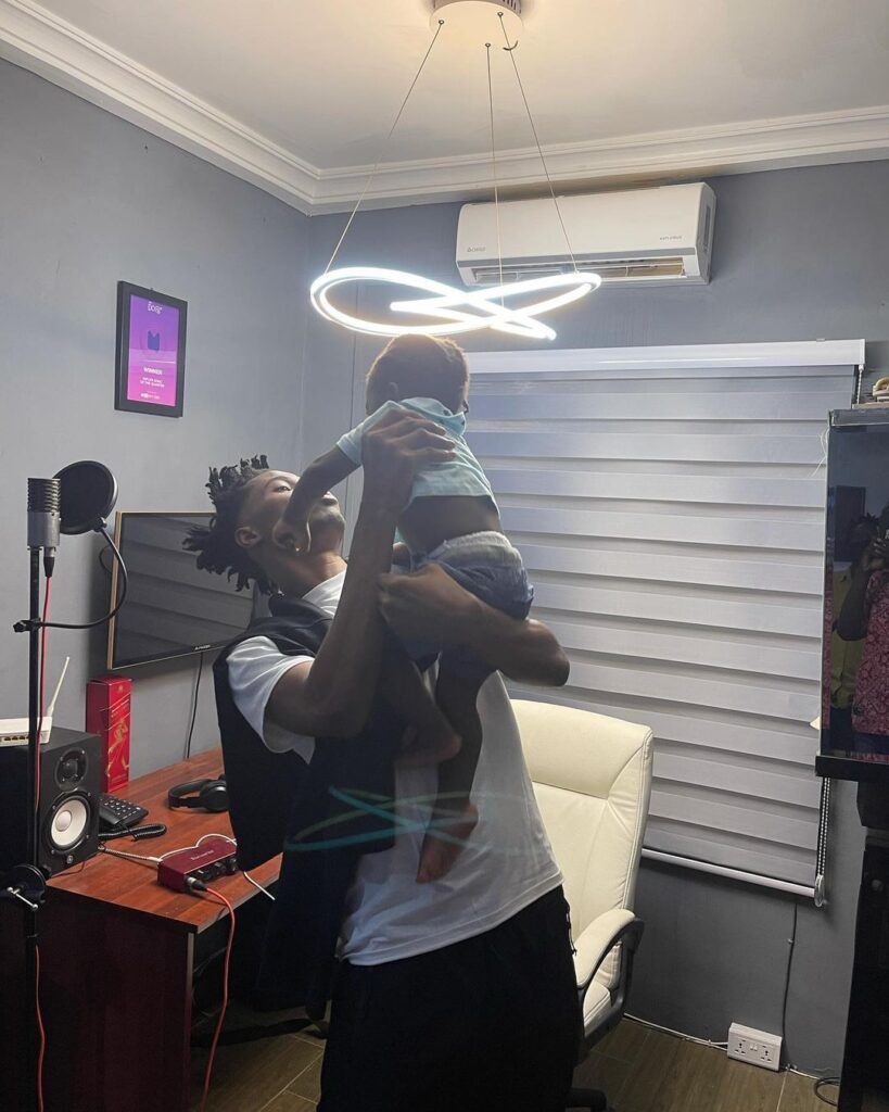 Daddy duties: Watch as Kwesi Arthur plays with Fameye's son in a new video