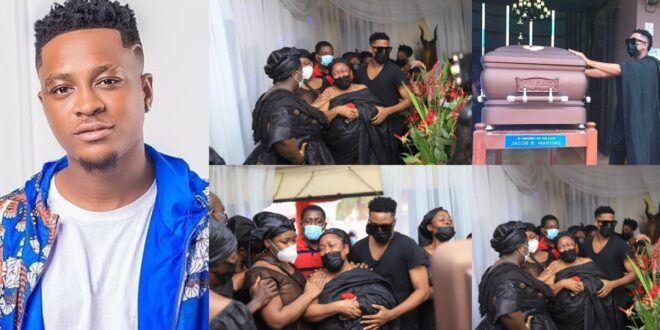 Sad: Musician Krymi consoles his mother as they bury his father (photos) 1