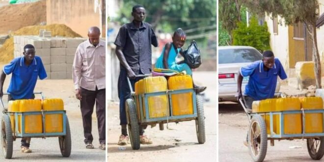 Man with only one hand pushes 10 jerrican water with wheelbarrow every day to make ends meet. 1